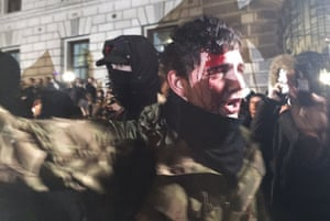 A protester with a bloodied head during the Million Mask march