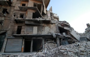 Sixty-year-old Abu Hassan, who has lost two sons and whose wife and two daughters were wounded in regime forces attacks, still runs a grocery store under his heavily damaged house