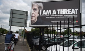 A billboard in Manchester. Theresa May toured north-east constituencies on Thursday.