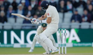 England's Joe Denly is struck by the ball.