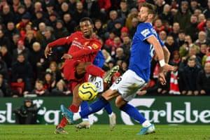 Georginio Wijnaldum slaps home Liverpool's fifth goal.