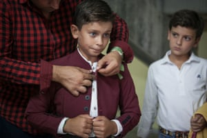 A teacher from La Algaba prepares his pupils for entry into the arena