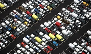Rows of new automobiles and vans, including Jeep Cherokee SUV automobiles, sit parked at the Port of Bristol.