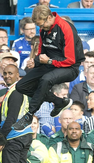 Jurgen Klopp leaps on the touchline after Liverpool's third goal.