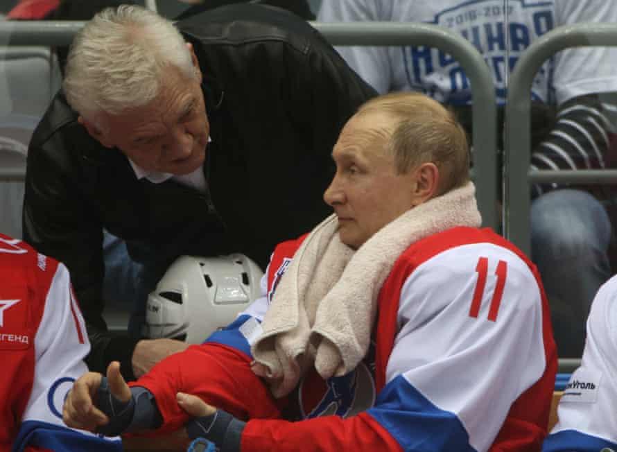Vladimir Putin listens to Gennady Timchenko during a hockey match at Black Sea resort of Sochi in May 2017