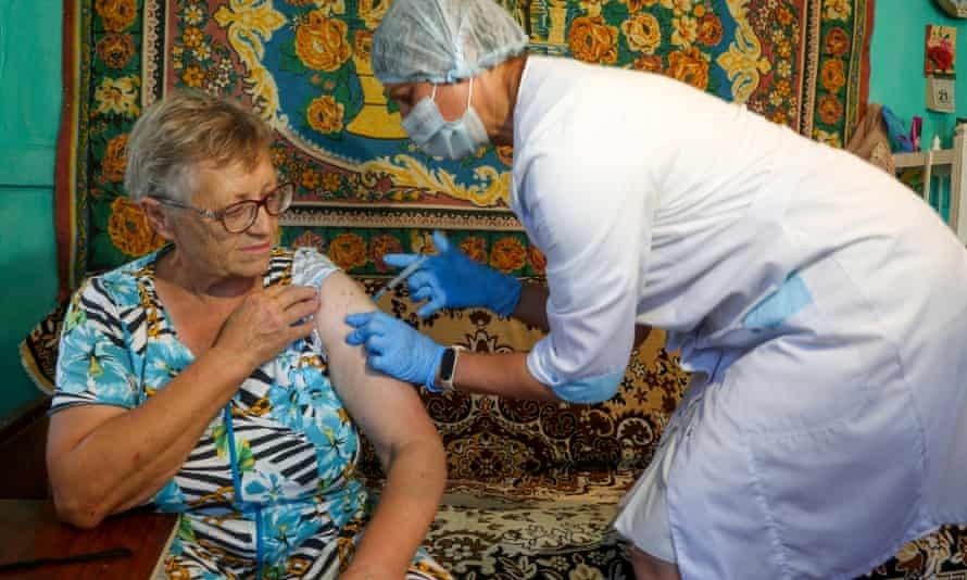 A woman receives a shot of the EpiVacCorona vaccine in the village of Talovka, Kamyshin District, Russia.