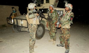 Afghan special force members take part in a night military operation against Taliban in the Nad Ali district of Helmand.
