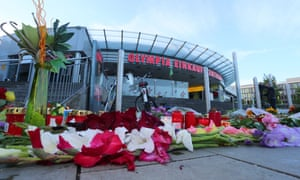 Candles and flowers in front of the shopping centre in Munich where an 18-year-old German-Iranian student shot nine people dead on 22 July.