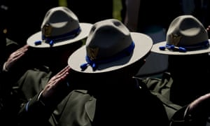 Washington DC, US. Law enforcement officers salute during the 38th annual national peace officers' memorial service on the west lawn of the Capitol building.
