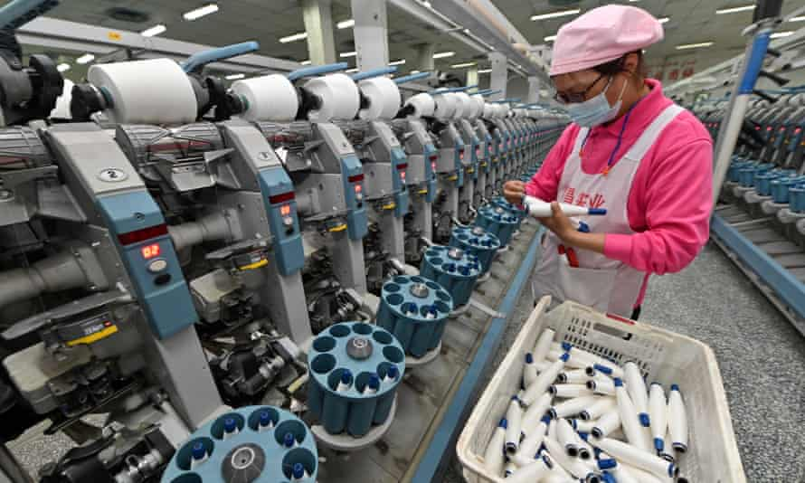 An employee working at a textile factory in Korla, Xinjiang Uygur Autonomous Region of China in April.