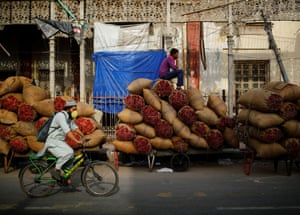 Delhi, India A worker sits on sacks of spices at a wholesale market after authorities eased lockdown restrictions