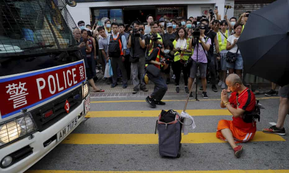 protester blocking path of a police van