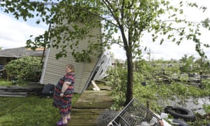 Angel Funk stands in the backyard of her home in Franklin, Texas, after severe weather on Saturday.