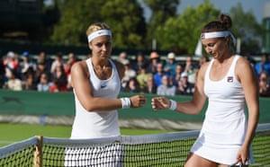 Sabine Lisicki (left) shakes hands with Yarosalva Shvedova of Kazakhstan after Lisicki lost in straight sets.