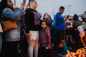 Mourners in front of the Marathon Clothing store where Hussle was killed.