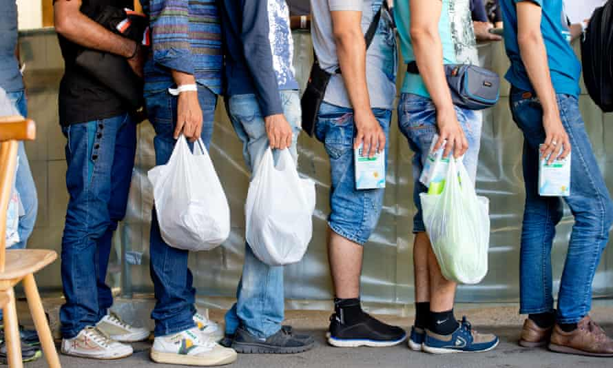 Refugees wait in line at the registration centre in Passau.