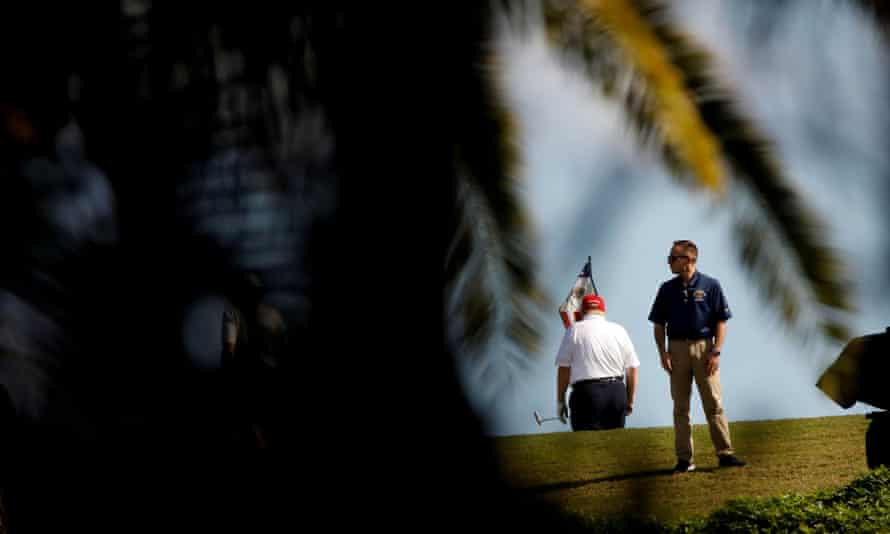 Donald Trump plays golf at the Trump International Golf Club in West Palm Beach, Florida, on Sunday.