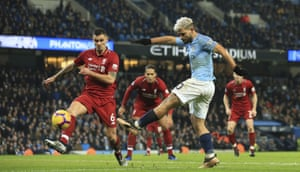 Sergio Agüero eludes Dejan Lovren to blast in Manchester City's opening goal.