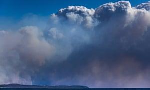 Smoke is seen in the distance near Tuncurry, NSW.