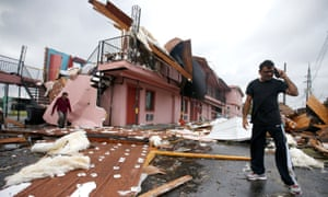 A man walks through the debris of once was a motel in New Orleans Tuesday.