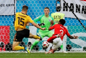 Belgium's Thomas Meunier gets ahead of Danny Rose to score in the fifth minute.