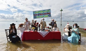 Activists held a Titanic-themed dinner party at Chalkwell beach, Southend-on-Sea, on 31 August to highlight rising sea levels.