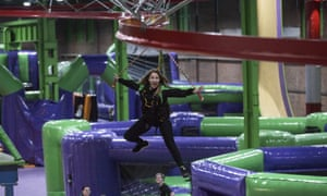 Woman swings from bouncy objects at Inflatspace, Newcastle, UK.
