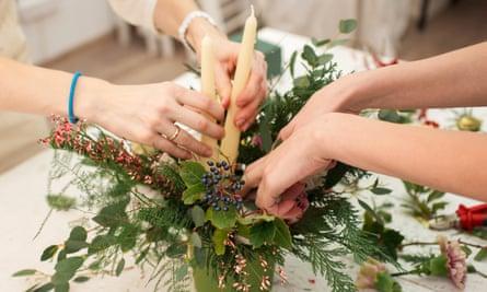 Florists create a Christmas candle display