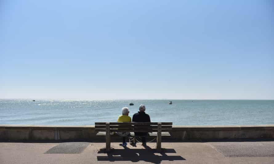 Retired couple on bench on the seafront at Southend on Sea, Essex