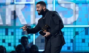 Drake accepts the award for best rap song.