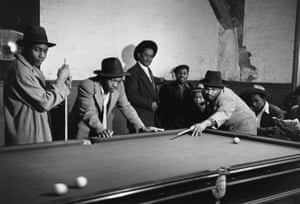 A group of West Indian men enjoying a game of snooker in a colonial hostel in Leaman Street, London. The photograph was taken for a feature by Robert Kee, 'Is There a British Colour Bar?' Picture Post: Hulton's National Weekly , 2 July 1949.