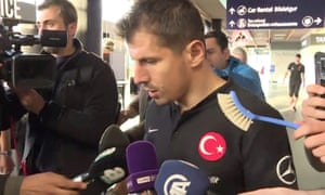 Turkey captain Emre Belozoglu had a washing-up brush held out to him in place of a microphone as he answered questions after the long wait at Keflavik airport.