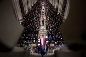 The flag-draped casket of former president George HW Bush.