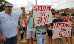 """Students defend the use of Afrikaans at the University of Pretoria, after the campus was shut down by opposing demonstrations. Posters read """"Afrikaans will stay""""."""