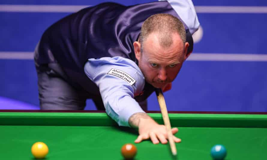 Mark Williams plays a shot during his win over Sam Craigie.