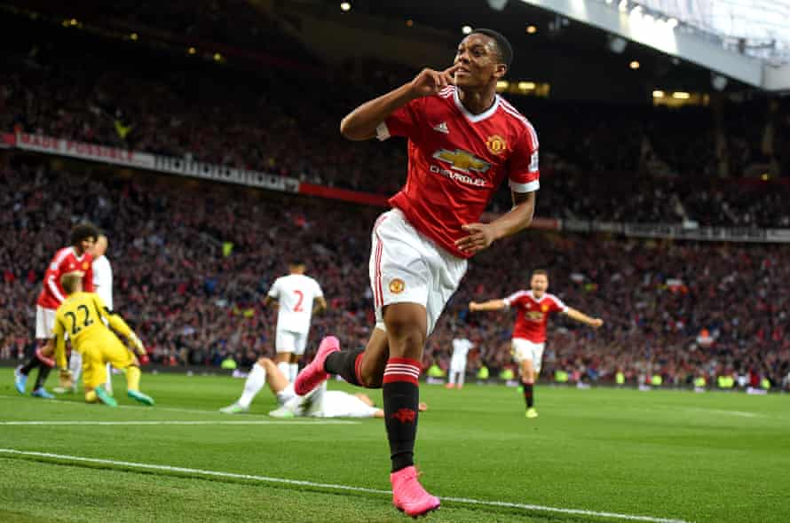 Manchester United debutant Anthony Martial celebrates scoring his side's third goal in their 3-1 win over Liverpool at Old Trafford.