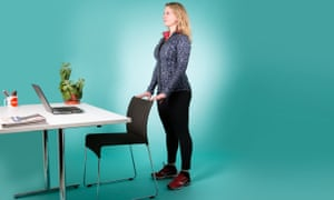 woman standing behind chair