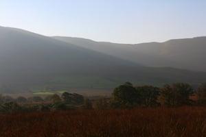 Mist lays across mountain slopes