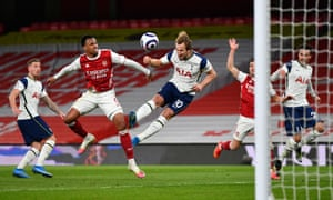 Tottenham Hotspur's English striker Harry Kane (C) jumps to head the ball but his effort is ruled out.
