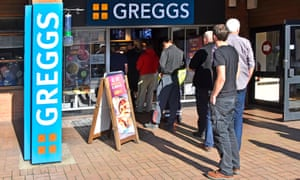 Men queuing to enter a Greggs bakery in Cheshire