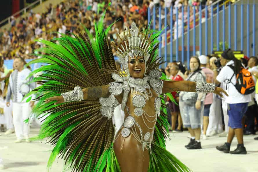 A member of the Academics of Rocinha samba school performs at Rio Carnival in February 2020.