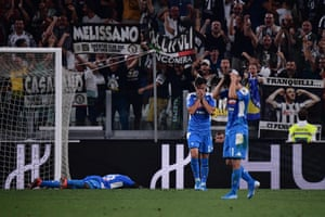 Napoli's Kalidou Koulibaly (left) reacts after shinning the ball into his own net.