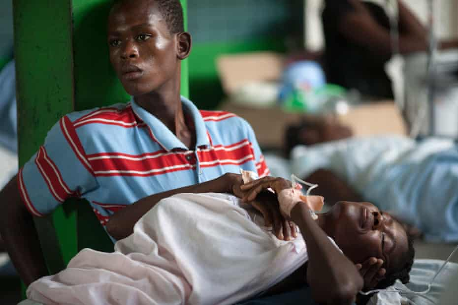 A boy cares for a relative in a ward at a cholera treatment centre run in Petite Riviere, a riverfront town in the Artibonite region of Haiti