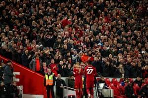 Liverpool fans applaud Divock Origi as he is substituted.