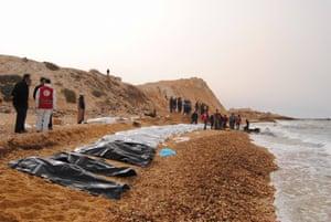 Al Zawiya, Libya Red Crescent volunteers gather bodies washed ashore