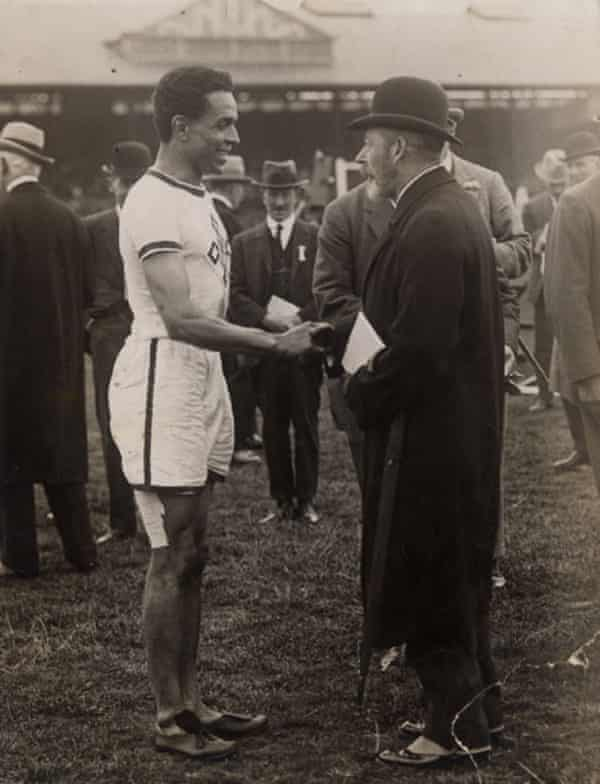 Edward is congratulated by King George V at the 1922 AAAs