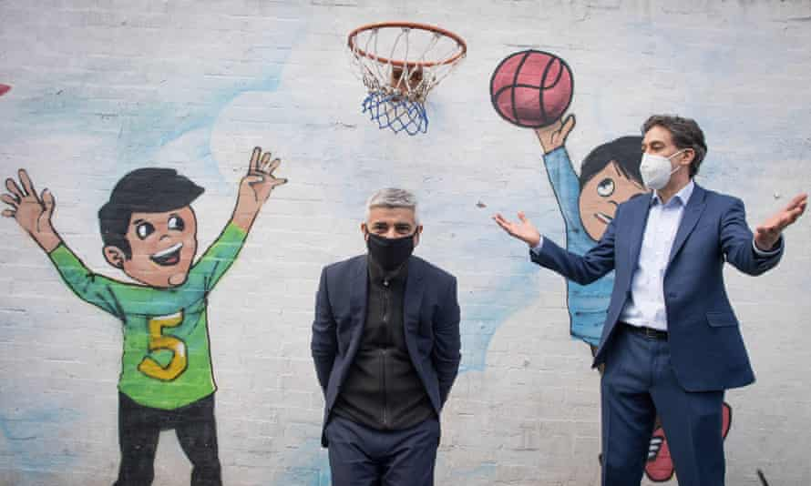 The mayor of London, Sadiq Khan (centre), with the shadow business secretary, Ed Miliband, on a visit to a playcentre in the north of the capital on Tuesday.