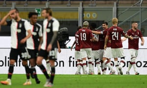 Milan forward Rafael Leão is congratulated by teammates