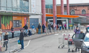 Long queues and social distancing at a Sainsbury's store.