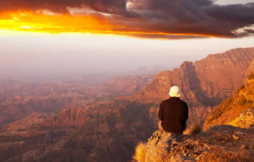 A hiker looking out over a canyon
